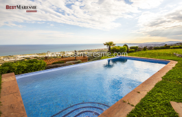 Contemporary design house with stunning sea views in 180 degrees, having a skyline background towards Barcelona